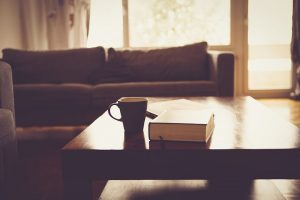 couch, a book and a cup